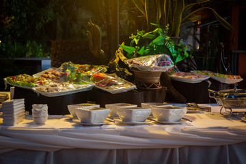 Raw meat in plastic wraps. Many buffet ready for service.