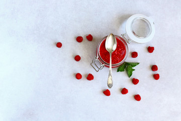 Flat lay composition with delicious raspberry jam on grey background