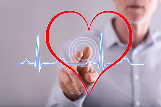 Man touching a heart beats graph