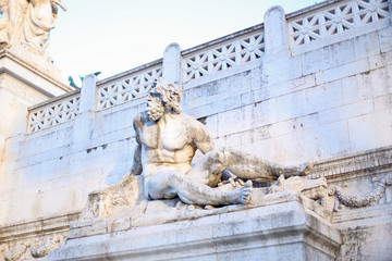 Old sculpture on building in Italy. Concept of traveling to Europe, Rome.
