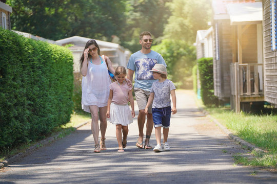 Family walking in camp village during holidays