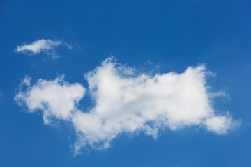 a large white cloud of interesting bizarre shape, on a blue sky, natural background