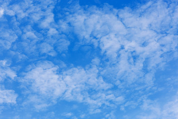 texture of shallow gentle clouds on a blue sky, natural background