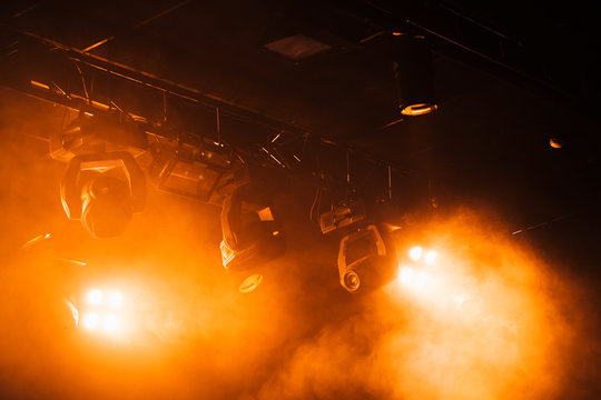 Red strobe lights with strong beams in smoke
