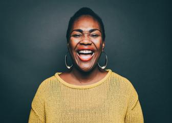 Studio portrait of woman laughing