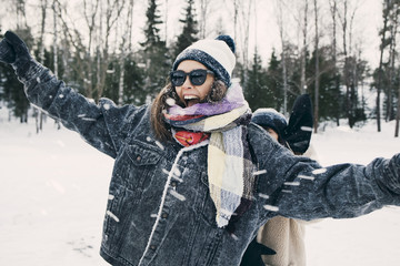 Woman laughing in winter setting