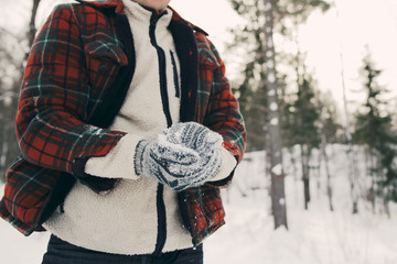 Midsection of man making snowball on snowy field at park