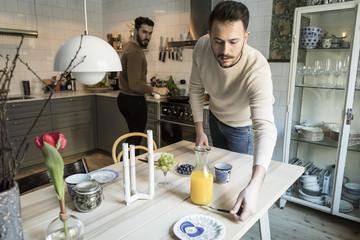 Two men in kitchen