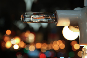 Included light bulb on background of lights