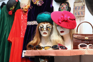 Mannequins in sunglasses, wigs and hats