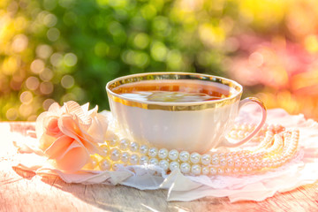 Cup of tea in summer sunny garden. Romantic concept