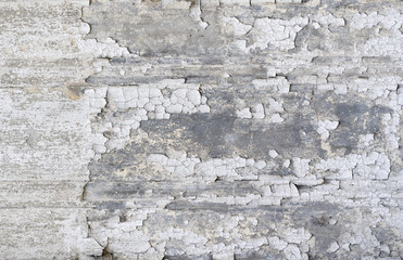 grungy old wall with peeling paint for backgrounds