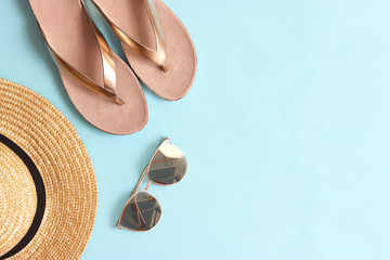 female city slaps, straw hat and glasses on a colored background top view. minimalism, insta. flatlay
