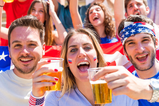 Fourth of July celebrations, Americans cheering with beers and USA flags
