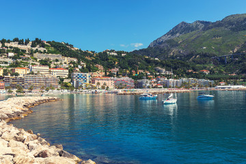 Papiers peints Scandinavie View of Menton city harbour from french Riviera in a beautiful summer day, France. Sea with mountains that make a beautiful contrast.
