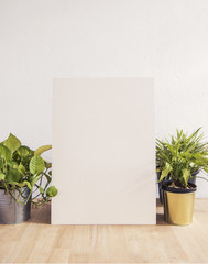 Blank white Photo Frame on Wooden for Design Mockup Template.