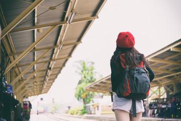 Asian woman traveler has waiting the train at Hua Lamphong station at Bangkok, Thailand.