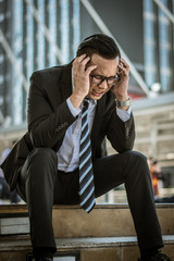 Businessmen are stressed,Men are having trouble