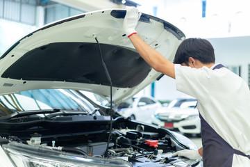 Auto mechanic working in garage, Car Repair Service center.