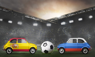 Spain and Russia flags on cars with soccer or football ball at stadium