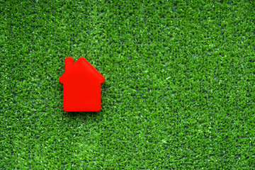 the figure of a house on a green background. ecology. housing in an ecologically clean area.