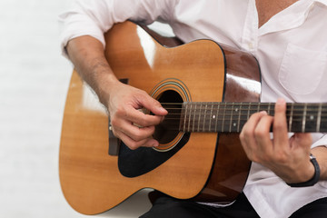 man playing guitar on white background