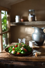 Green Salad with Grilled Chicken and Tomatoes in a Rustic Farmhouse Kitchen