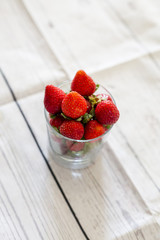 Fresh strawberries close up on wooden background