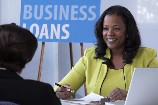 Business loan officer meeting with her client