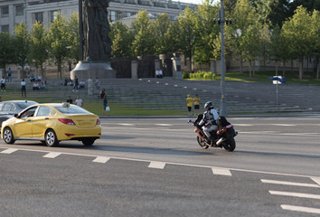 The motorcyclist on the road of Moscow, a road near Kremlin