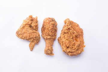 Delicious hot and crispy fried chicken isolated on a white background