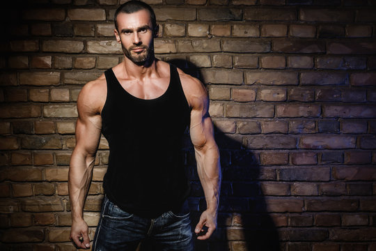 Bodybuilder wearing black tank top with empty space for your text or logo