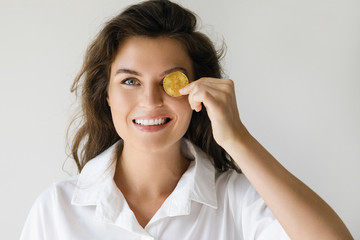 Young woman with a Bitcoin cryptocurrency