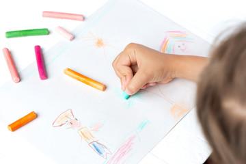 A girl draws a crayon, a pastel, a journey through the sea. Ship, sailor, boy, palm, sea