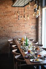 Restaurant table full of food