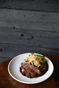 Grilled steak with crispy onions