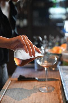 Bartender making a Manhattan