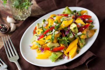 Healthy vegetable salad with mango, avocado