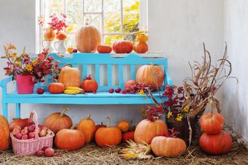pumpkins, apples, flowers in old room