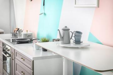 Tea set on table in modern kitchen