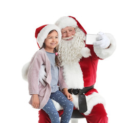 Authentic Santa Claus taking selfie with little girl on white background