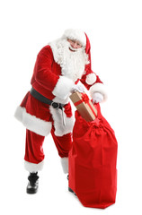 Authentic Santa Claus with red bag full of gifts on white background