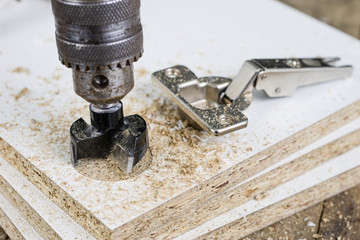 Milling cutter for fixing hinges in chipboard. Joinery accessories for furniture construction.