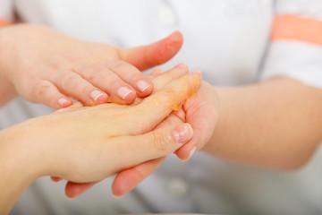 Woman getting hand massage at beauty salon