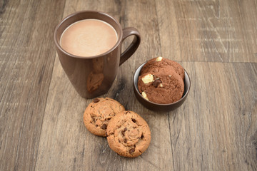 Cookies with milk on a wooden background stock images. Cookies with chocolate milk stock images. Biscuits on a wooden background. Cup of chocolate milk with snack