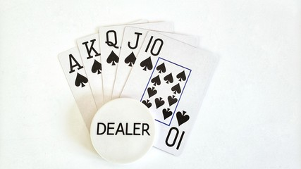 Royal Flush and a dealer button on a white background