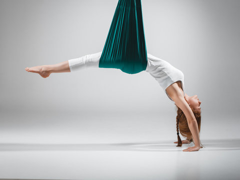 Different inversion aerial yoga with a hammock