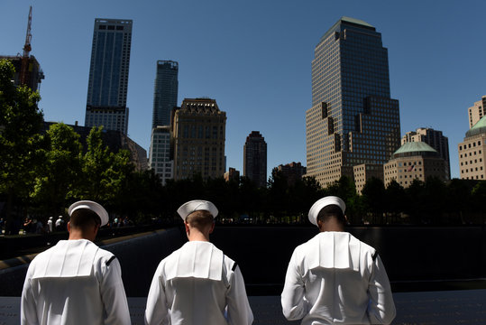 US Navy sailors during visiting the 9/11 Memorial in New York City commemorating the September 11, 2001 attacks.