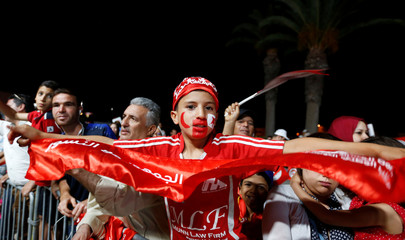 Fans react during the broadcast of the FIFA World Cup Group G soccer match between Tunisia and Panama, in Tunis