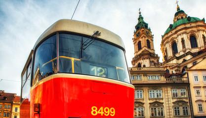 Historical tram and Saint Nicholas Church in the Lesser Town of Prague, Czech Republic Europe